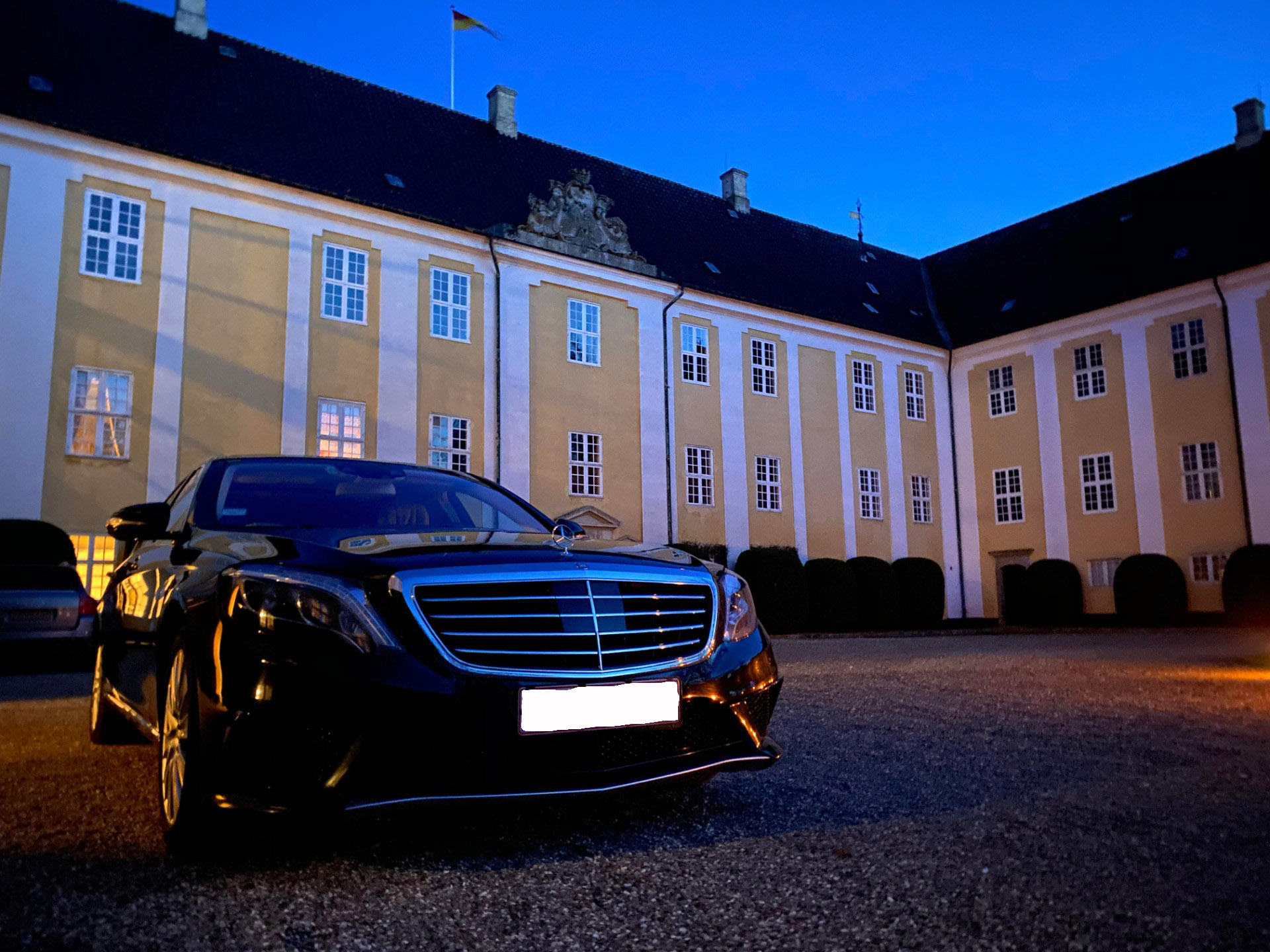 Black Mercedes S-Class waiting client